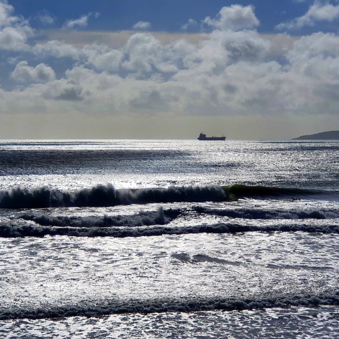 waves on Perranuthnoe beach, cargo ship on the horizon