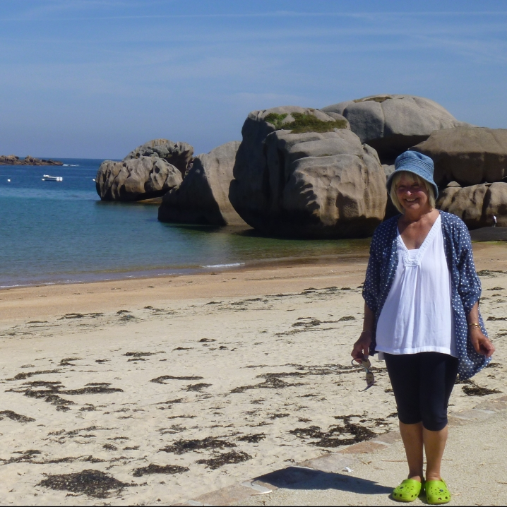 woman in blue hat on beach