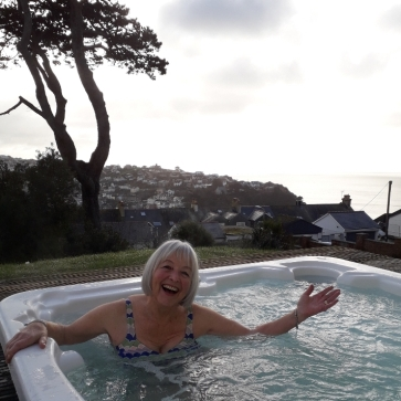 happy woman in jacuzzi
