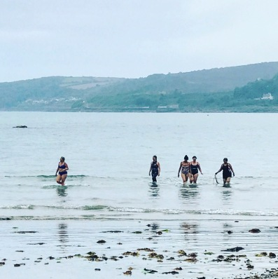 women in the sea