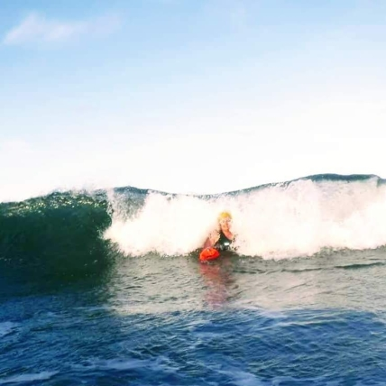 The joy of sea swimming: Lynda delights in the sea as a wave breaks behind her